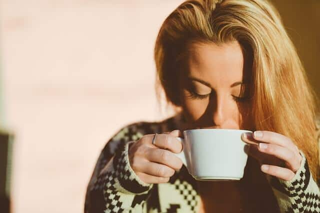 Woman drinking green tea for weight loss