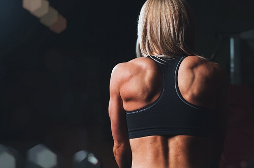 A girl doing working out. Cardio or strength training