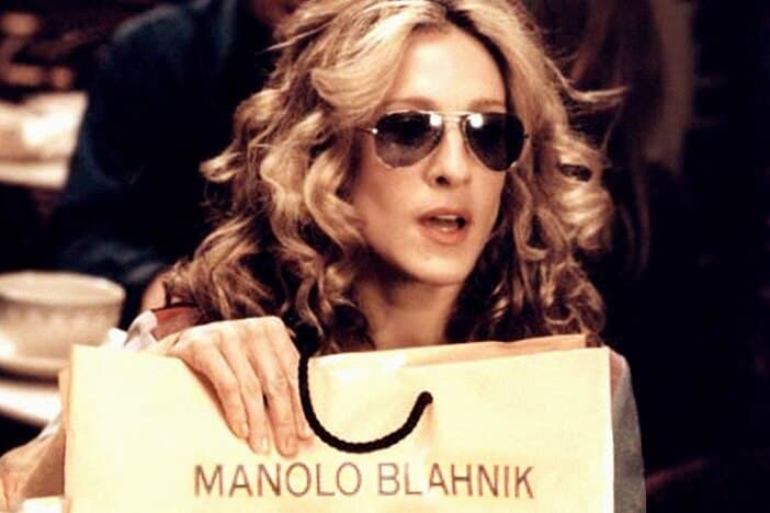 Carrie holding Manolo Blahniks