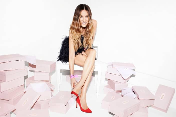 Carrie with lots of shoe boxes