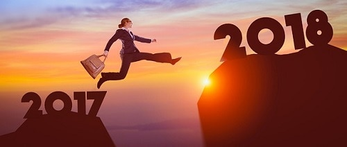 A woman jumping from 2017 to a higher elevated 2018 representing success- Blogging resolutions illustration