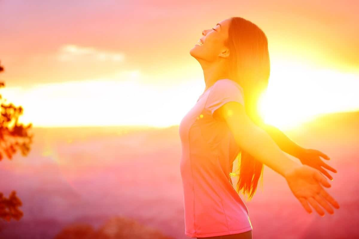 Free happy woman enjoying nature sunset