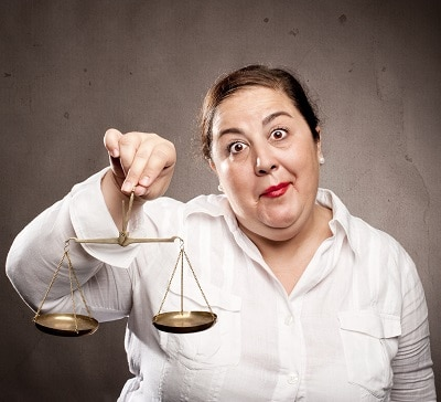 fat woman holding a scale